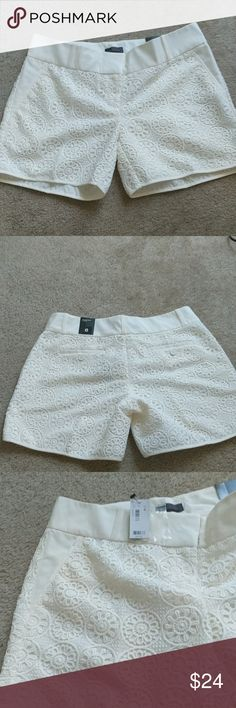 Off White/Cream Lace Shorts Off white/cream shorts with heavy lace overlay...slit pockets in front and button pockets on back...new, never worn with tags The Limited Shorts