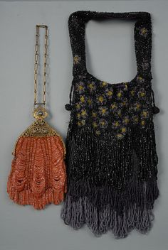 TWO BEADED BAGS, 1910-1920s Black, grey and yellow overall beaded floral with three tiers of looped beaded fringe, beaded strap, no lining. Length 10, width 6, strap 6 inches. Excellent. One rose beads swag style with beaded looped fringe, brass frame. Length 6 1/2, width 6, chain 5 inches. Lining torn, good.