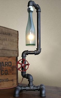 30 Amazing Diy Bottle Lamp Ideas - I like this lamp but I don't know where I would (be allowed to) put it. A neat touch would be to make the valve handle the on-off switch.