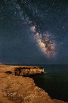 A million stars to witness along Cape Greco Seacaves Cyprus  I put a lot of effort for this photo. So much trial and error. I have made 2 versions of it but i was not happy with them. I felt they were missing something. The composition is exactly what i had in my head allowing the dry land to lead to the milkyway. There was a ton of light pollution but i manage to correct it as much as possible. This is my first post of a milkyway with foreground this year(a little bit late eh?). My goal…