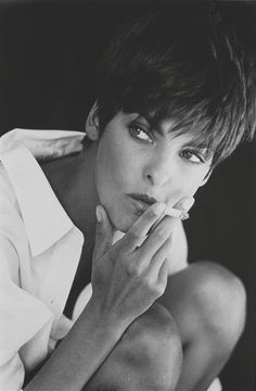 Linda Evangelista, this looks just like my mother back in the 90's. Gorgeous, short hair, chain smoking, those eyes.
