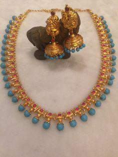 Pota ruby studded gold parrot necklace with round blue turquoise beads embellished on the edges , Paired with nakshi work huge jhumkas and. Simple Necklace Designs, Gold Necklace Simple, Necklace Set, Antique Necklace, Indian Jewelry, Beaded Jewelry, Gold Jewelry, Wedding Jewelry, Jewelery
