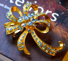 LARGE BOW BROOCH Blue Rhinestone Accented  Extra Large Vintage Gold Toned Multi Looped Bow Brooch With Aqua Colored Rhinestone Accents by StudioVintage on Etsy