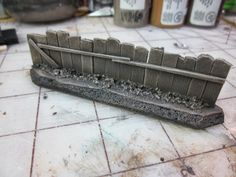 A very nice fence idea. Just add a poster or some a graffiti to make it fit nicely into your own terrain.
