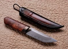 "Anders Högström: ""Amboyna Kwaiken""- 12cm 4 3/4"" blade w hamon. Sculpted bronze fitting and amboyna burl handle. Matching custom leather belt sheath."