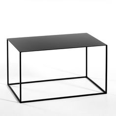 Lacquered metal.This occasional table goes for an elegant look with its sleek tubular framework.Size: Length 70 x depth 45 x height 40 cm.