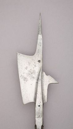 Halberd | Swiss | The Met Date:mid-15th century Culture:Swiss Medium:Steel, wood (oak), iron Dimensions:L. 88 1/2 in. (224.7 cm); L. of head 16 1/4 in. (41.3 cm); W. 7 5/8 in. (19.3 cm); Wt. 6 lbs. 2 oz. (2780 g) Classification:Shafted Weapons Credit Line:Gift of Stephen V. Grancsay, 1942 Accession Number:42.50.18