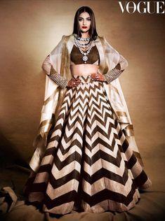 Sonam Kapoor in a pearl white black Anamika Khanna lehenga. #Frugal2Fab Party Wear Indian Dresses, Designer Party Wear Dresses, Indian Gowns Dresses, Indian Bridal Outfits, Dress Indian Style, Indian Fashion Dresses, Indian Designer Outfits, Choli Designs, Lehenga Designs