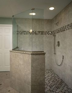 Large Walk-In Shower in this Kansas City Master Bath. Tile Floor and Walls With Glass Enclosure and Mosaic Tile Floor and Mosaic Tile Border. Bathrooms By Design Connection, Inc. | Kansas City Interior Design http://designconnectioninc.com/portfolio #WalkInShower #BathroomRemodel #InteriorDesign