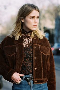 A shearling cropped jacket is worn with a lace top