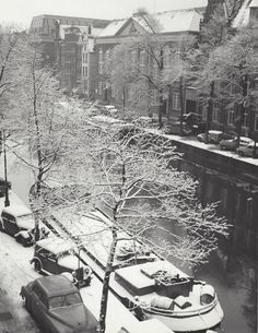1948 - 1952. View on a snow-covered Kloveniersburgwal in Amsterdam. The Kloveniersburgwal is a canal in the center of Amsterdam that runs south from Nieuwmarkt to the river Amstel. The canal was dug at the end of the 15th century. The Geldersekade, the Singel and the Kloveniersburgwal together formed moat around the city. The east side became populated in the 17th century and has a few grand mansions, like the Trippenhuis. Photo Kees Scherer. #amsterdam #1948 #Kloveniersburgwal