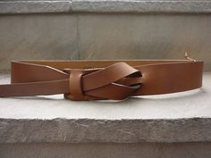 This leather belt is of an exquisite dark Camel. A classic recreation of a 60's unisex nickel free belt design. Simple and comfortable, this one piece belt uses no metal bu... #trending #etsy #tan