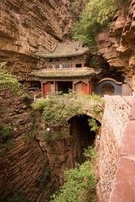 Moon Bridge Temple in China. The perfect balance of man and nature. I can see a mans face in the rocks to the right? Can anyone else?