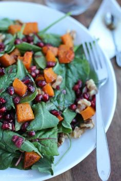 This roasted Butternut Squash Pomegranate Spinach Salad is a hearty salad recipe that is wonderful in the winter & includes simple healthy vegan ingredients. Quinoa Avocado Salad, Spinach Salad, Easy Salad Recipes, Side Dish Recipes, Fall Recipes, Holiday Recipes, Salad Dishes, Winter Salad, Roasted Butternut Squash
