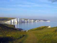 An elderly couple take a stroll along the South Downs in July Beautiful Seven Sisters as a back drop! Pictures Of England, The Beautiful South, Fantasy Places, Beautiful Places To Visit, Beautiful Beaches, English Countryside, East Sussex, Ciel, Adventure Travel