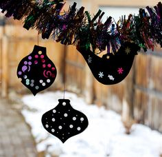 cut out two shapes, paper punch holes. place different colors of tissue paper on the ornament glue the two shapes together