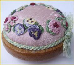 I ❤ pincushions . . . Pansy pin cushion kit- A keepsake pincushion by Laura Bateman. Complete includes hardwood base, stamped fabric, specialty fibers, needles and complete instructions!