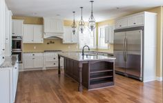 What a beautiful LDK custom kitchen! We absolutely love the pendant lights and custom island, don't you?! At LDK, the way you live is the way we design and build your home! http://ldkhomes.com/