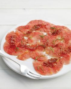 Watermelon Carpaccio - Sweet watermelon shavings get a savory snap from ribbons of scallions and crisped prosciutto. Sweet Watermelon, Watermelon Recipes, Raw Food Recipes, Appetizer Recipes, Salad Recipes, Healthy Recipes, Appetizers, Cantaloupe Recipes, Party Recipes
