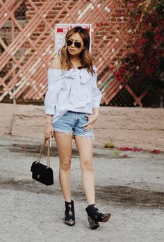 Browse the best summer street style outfit ideas at @stylecaster | 'Spread Fashion' blogger's off-the-shoulder bow blouse, cutoff denim shorts, black booties