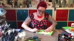 Dyan Reaveley shares techniques for applying her new Dylusions Paints using baby wipes and blending tools in journals and art projects.