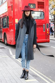 Hat is by Boy Boutique. Joseph coat, a Ralph Lauren jumper and Topshop jeans. Boots are by Saint Laurent and bag is by Chanel.