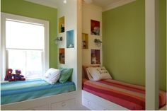 This is cool too, book shelves behind the beds with painted cubbies  From 12 cool ideas for shared kids rooms