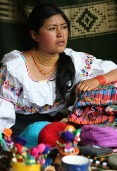 Otavalo woman selling products in the market