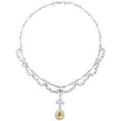 Antique  5.06 Carat Fancy Yellow Pear Shaped Diamond Drape Necklace | From a unique collection of vintage drop necklaces at https://www.1stdibs.com/jewelry/necklaces/drop-necklaces/