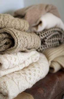 Large sweaters tucked in small cubicles or small dressers by the front and back door for a lady who needs some extra warmth when stepping out on a chilly day.