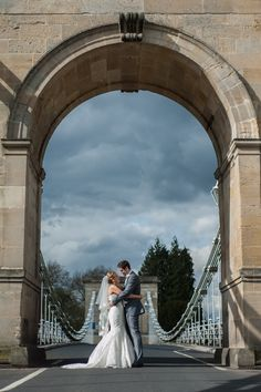 Marlow wedding photographer bride and groom stop traffic on the historical Marlow bridge crossing the Thames