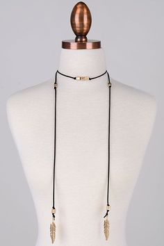 Description: We love this unique wrap necklace with cute feather charms! Wear this beauty by wrapping it around your neck in a choker-style, and let the long ends dangle down the front. Decorative bea