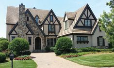 Browse Tudor house plans with photos. Compare hundreds of plans. Watch walk-through video of home plans. Style At Home, Maison Tudor, Casas Tudor, Casa Estilo Tudor, Tudor House Exterior, Exterior Houses, English Tudor Homes, Tudor Style Homes, French Country Bedrooms