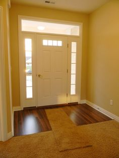 Ashford Ii With Upgraded Wood Laminate Flooring And Transom For More Light Possible Front Door