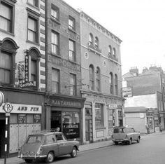 """Dublin History ~ Capel Street Kilmartin Betting shop in the distance Dolphin Discs record shop"" Dublin Street, Dublin City, Old Pictures, Old Photos, Grafton Street, Ireland Homes, Dublin Ireland, Great Britain, Travel Destinations"