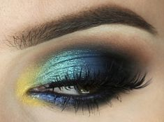 Bold and colorful, this look is sure to attract attention and is super easy to recreate! Products Used Makeup Geek Eyeshadow in Shimma Shimma