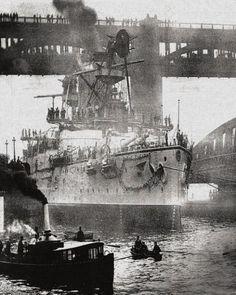 Shikashima class war ship passing the swing bridge