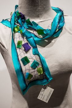 This aqua and chocolate scarf from Artisan Passions can be found at our Museum Store.