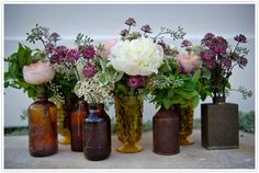antique glass medicine bottles with pink and purple flowers