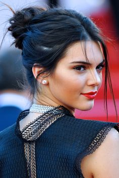 Kendall Jenner Straight Dark Brown Bun, Face-Framing Pieces, Updo Hairstyle | Steal Her Style