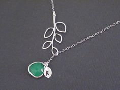 Sale 10% Off Personalized Initial-Five Leaf Branch And Fancy Drop Opal Green Pendant With Initial Leaf-White Gold Plated Lariat Necklace. $23.50, via Etsy.