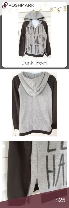 "⚫️ BOGO 1/2 OFF Junk Food Hooded Sweatshirt Top  BOGO 1/2 OFF...see Sale Post in my closet for more details This hi-lo pullover hooded sweatshirt with side slits is too cute!! Factory distressed to give that 'worn' look so it looks faded bc it is! It's supposed to look that way  nice and comfy for the cool nights...says ""Don't Tell Me What To Do"" on the front Brand: Junk Food Size: Medium (women's) Measurements: length - 24"" front, 25.5"" back; chest - 20.5"" flat, unstretched Condition…"