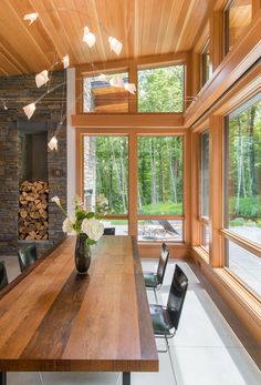 Wood framed windows provide this dining room views of the surrounding woods. A large wood table also compliments the wood ceiling and window frames. Modern Shed, Modern House Design, Wood Table Design, A Frame Cabin, Shed Design, Design Design, Design Ideas, Maine House, Architecture Design