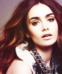 Lilly Collins! She is a great actress she was soo good in blind side and in city of bones! (her eyebrows just kinda bug me)