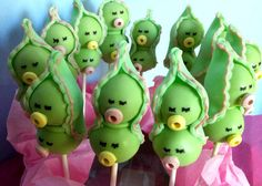 THESE ARE CAKE POPS!  PICTURE THEM WITHOUT THE CANDY --- JUST SMALL SMILES!   WOULD TIE IN WITH THE PEAS IN A POD THEME.  LOVE IT:)  THERE ARE LOTS OF OTHER CAKE POP RECIPES ON THIS SITE TOO.  FOR THE DESSERT TABLE.