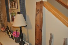 """Our second most popular growth chart - especially for those who like the barn wood look.  These are 6 feet tall and 8 inches wide with measurements that begin at 6"""" and go to 6'6"""" to allow for baseboards unless requested otherwise.  We hand paint the lines and numbers.  Each one is unique!  If you prefer a piece of lumber that has no blemishes, a lot of character, super dark or very lightly stained - please let us know.  We want to make sure you are happy!"""