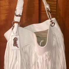 LIKE NEW Carlos Santana White Fringe Purse EXCELLENT condition, lots of room, perfect for summer ... Smoke free home. Carlos Santana Bags