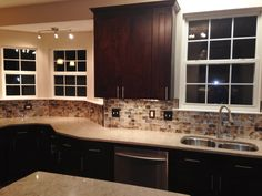 Kitchen Remodel by M.A.K. Construction Services- Craftsman Java Maple Wood Cabinets, Silestone Countertops, Undercabinet LED Lighting, Stainless Steel Appliances, Double Undermount Stainless Steel Sink