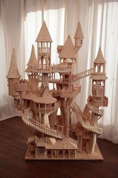 Miniature elf village made with popsicle sticks