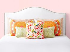 HGTV Magazine shows you a series of pillow combinations that immediately up your bedroom style.